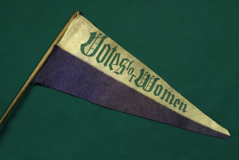 Banner saying Votes for Women