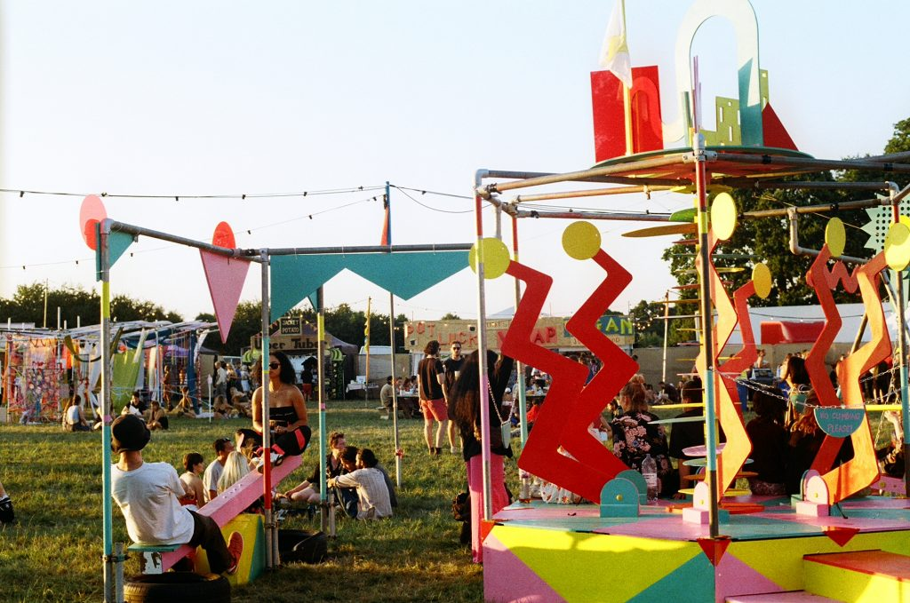 Brainchild festival 2018 - Kristin Minchin and Oscar Murray's playground built for Brainchild 2018. Photo shows the installed playground with festival goers on the see-saw and roundabout