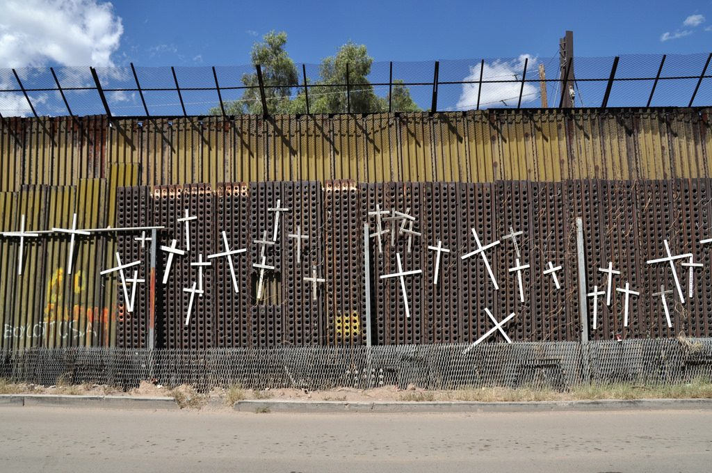White crosses with the names of those who have died crossing the US border adorn the Mexican side of the wall in Heroica Nogales, Mexico.