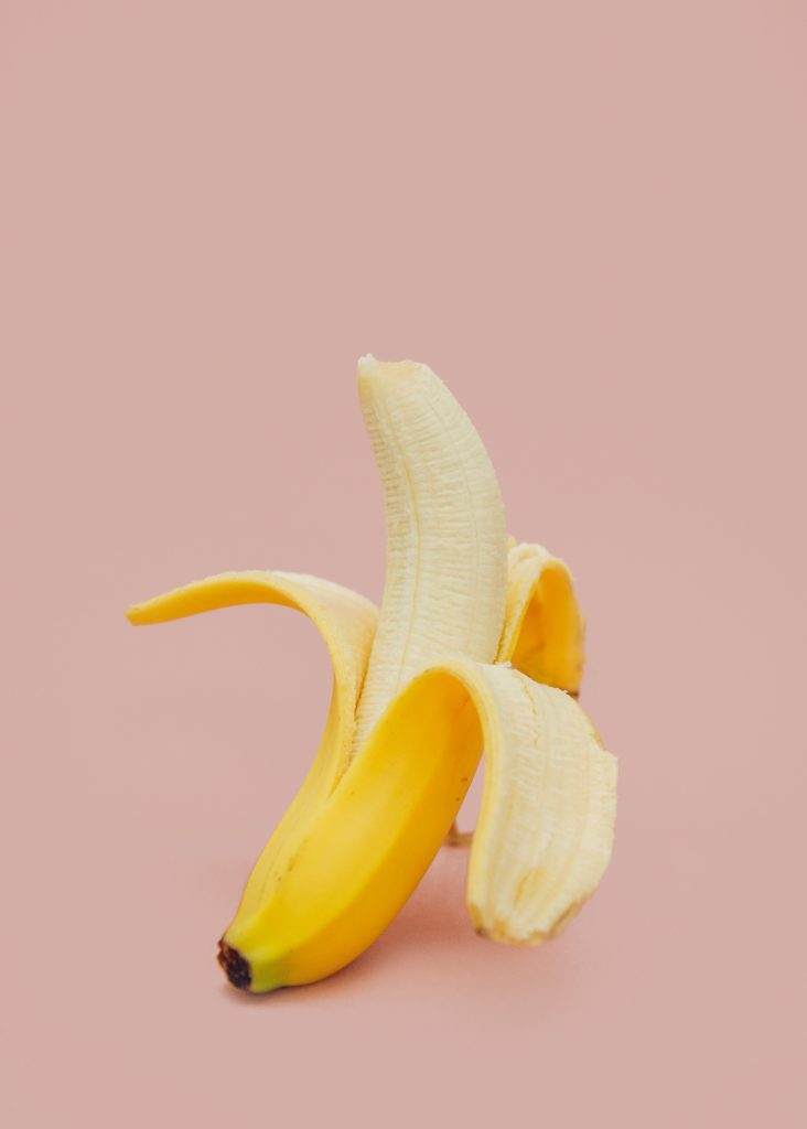 a partially unpeeled banana