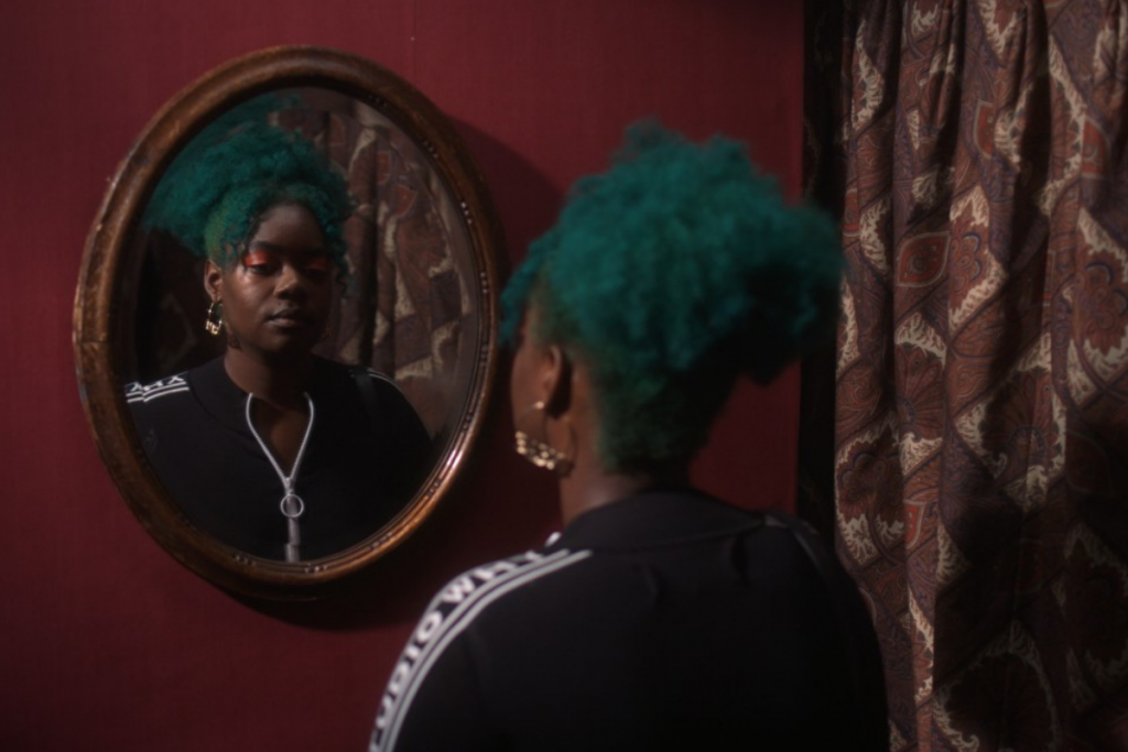 Bernice Mulenga stares in the mirror in The Muse