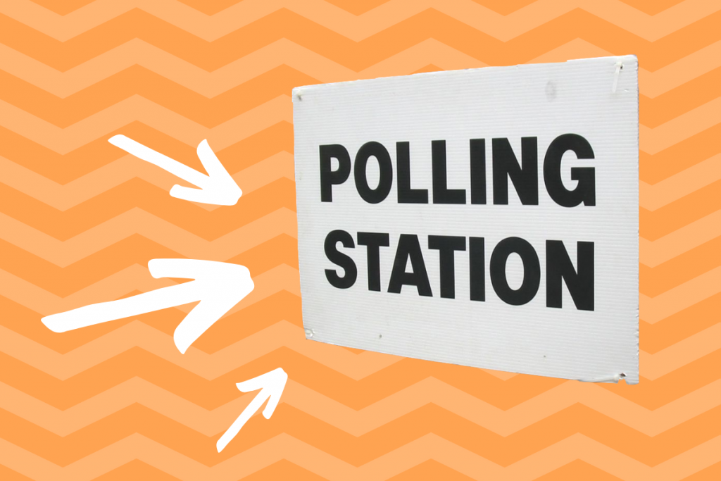 sign saying 'Polling Station' and three arrows pointing at it