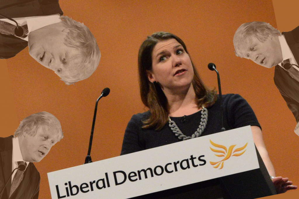 Jo Swinson at a podium marked 'Liberal Democrats' with images of Boris Johnson around her