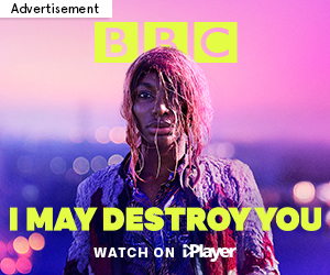 "Advert for BBC's new drama 'I May Destroy You' written by and starring Michaela Coel. Advert shows Michaela Coel as Arabella with wet pink hair against a bright and blurred evening cityscape, with the words ""I May Destroy You - Watch on iPlayer"""