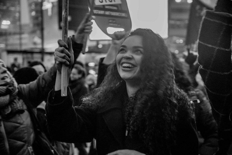 Sara-Alexandre-black-woman-attending-Poland-abortion-protest-holding-sign