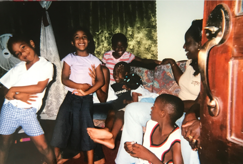 Image shows children spending Christmas in the Caribbean.